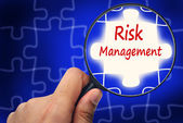 Risk management word. Magnifier and puzzles. — Stock Photo