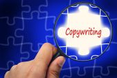 Copywriting word. Magnifier and puzzles. — Stock Photo
