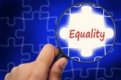 Equality word. Magnifier and puzzles. — Stock Photo