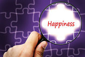 Happiness word. Magnifier and puzzles. — Stock Photo