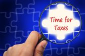 Time for Taxes word. Magnifier and puzzles. — Stock Photo