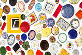 Colorful ceramic plates on the wall — Stock Photo