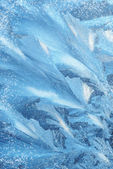 Ice patterns on winter glass — Stock Photo