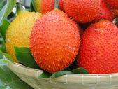 Gac fruit in basket — Stock Photo
