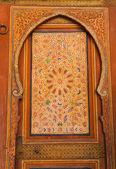 Ornate painted woodwork El Bahia Palace in Marrakesh — Stock Photo