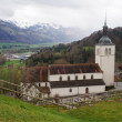 Beautiful landscape with church , Alps mountains and fields in G — Stock Photo #75821747