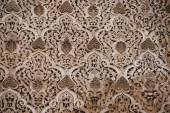 Beautiful ornate carving on the plastered walls in the courtyard — Stock Photo