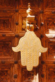 Old knocker in the shape of a hand on a door  in Marrakech — Stock Photo