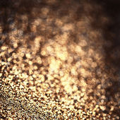 Background with blinking lights and golden defocused texture — Stock Photo