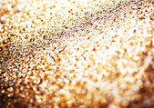 Glitter background with blinking lights and golden texture. — Stock Photo