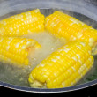 Corn boiling in pot — Stock Photo #74860077