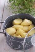 Potatoes in a pot — Stock Photo
