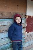 Dramatic portrait of a little homeless boy — Stock Photo