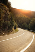 Mountain road at sunset — Stock Photo