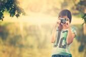 Pretty photographer girl — Stock Photo