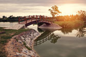 Bridge in the park at sunset — Stock Photo