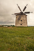Old windmill in field — Stock Photo