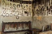 Wall with tools for horseshoes — Stock Photo