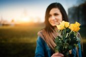 Woman with yellow rose — Stock Photo