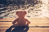 Teddy bear on pier — Stock Photo