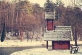 Wooden house near lake — Stock Photo