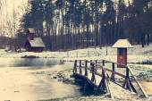 Bridge on forzen lake — Stock Photo