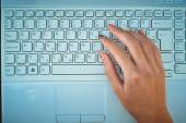 Hand on the keyboard of a laptop — ストック写真