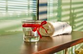 Towel and candle holder — Stock Photo