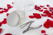 Manicure composition with rose petals — Stock Photo