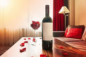 Bottle of wine on table — Stock Photo