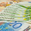 A lot of euro banknotes - large sum of money — Stock Photo #59699369