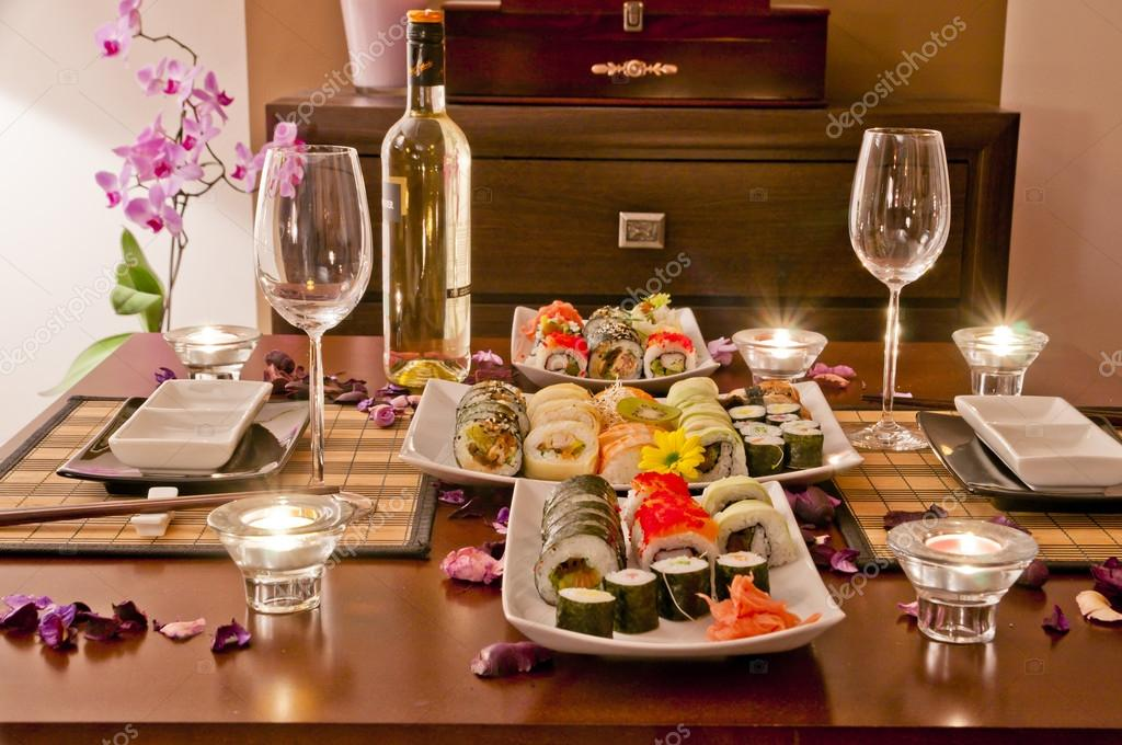 Romantic dinner at home sushi and wine stock photo for Romantic meal ideas at home