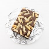 Pile of brownies isolated on white — Stock Photo
