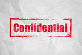 Confidential stamping on white corrugate Paper — Stock Photo