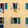 Windows with laundry — Stock Photo #57484027