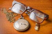 Old silver pocket watch and glasses — Stock Photo