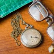 Pocket watch with glasses and  case — Stock Photo #64572503