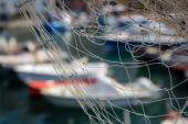 Fishing nets against boats in port, selective focus — ストック写真