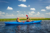 Couple kayaking on river — Stock Photo