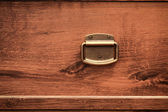 Brass knob on an oak chest of drawers — Stockfoto