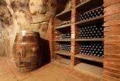 Keg and wine bottles — Stock Photo