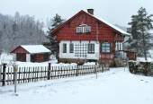 Cottage during snow storm — Stock Photo