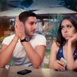 Young Couple Having Problems with Their Smart Phones — Stock Photo #53277571