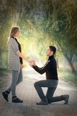 Kneeling Man Proposing with an Engagement Ring — Stock Photo