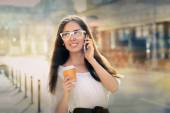 Young Woman with Coffee Cup on the Phone Out in the City — Stock Photo