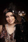 Retro 20s style woman holding champagne glass — Stock Photo