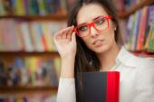 Young Woman Wearing  Glasses and Holding a Book — Stock Photo