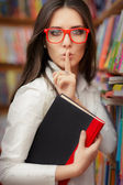 Young Woman Asking for Silence in the Library Room — Stock Photo