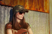 Meditative Young Woman Soldier in Camouflage Outfit — Stock Photo