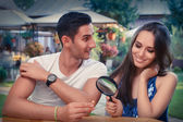 Happy Woman Testing Engagement Ring from Boyfriend with Magnifier — Stock Photo